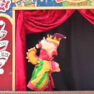 Rod Burnett performing his international Punch and Judy Show at Mr Punch's 350th Birthday Celebration in Lincoln July 2012